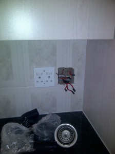 Kitchen renovations... wall tiling completed. Installation of new electrical plugs and isolator switches in progress.