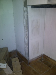 Kitchen renovations... wall tiling in progress.