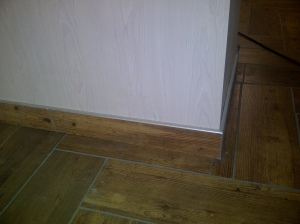 Removed old tiles with a tile chipper. New floor and skirting tiling.