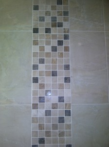 Bathroom renovation... Wall tiling.