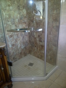 Bathroom renovation... Shower, walls and floor tiled with mosaic tiles on shower floor.