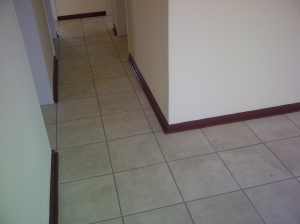 New floor tiling. Walls and skirting painted.